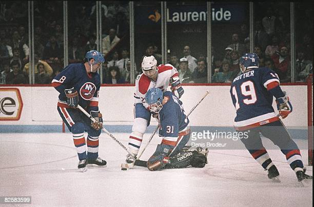 Canadiens forward Guy Carbonneau in close alone against Islanders goaltender Billy Smith in a game at the Montreal Forum during the 198687 season