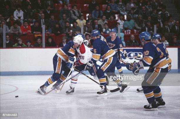 Canadiens forward Mats Naslund surrounded by Blues players at the Montreal Forum during the 1987-88 season.