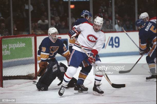 Canadiens forward Ryan Walter screen Blues goaltender Greg Millen in game action at the Montreal Forum during the 1987-88 season.