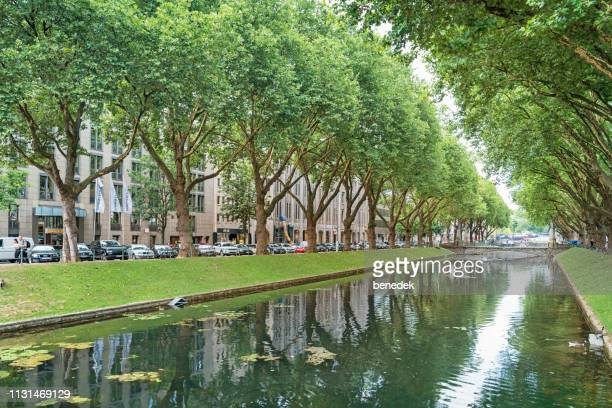 canal along konigsallee in downtown dusseldorf germany - düsseldorf stock pictures, royalty-free photos & images