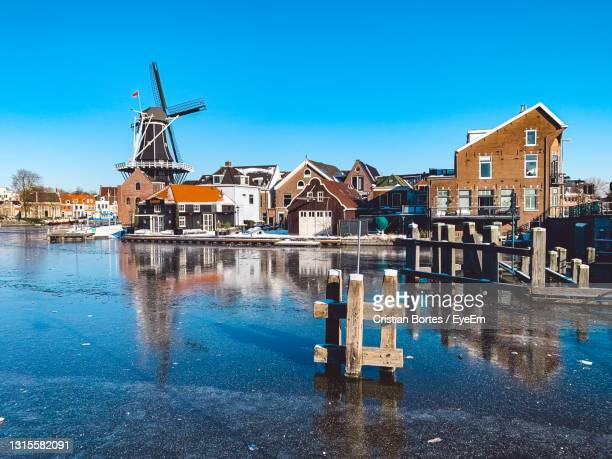 canal amidst buildings against blue sky - bortes stock pictures, royalty-free photos & images