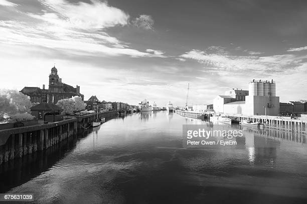 Canal Amidst Buildings Against Cloudy Sky At Great Yarmouth