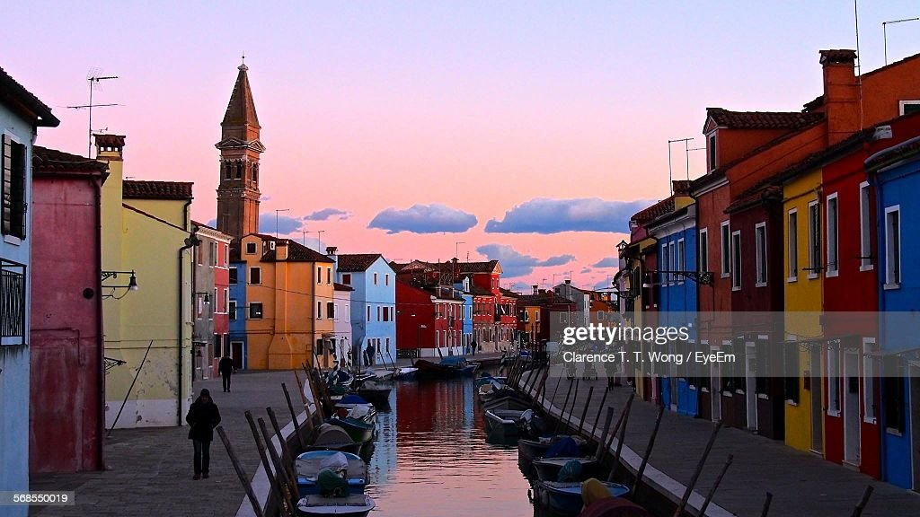 Canal Amidst Buildings Against Sky During Sunset : Stock Photo