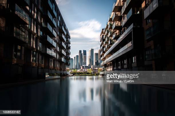 canal amidst buildings against sky in city - montreal stock pictures, royalty-free photos & images
