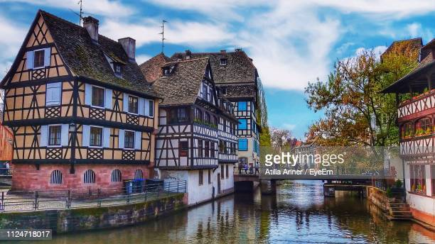 canal amidst buildings against sky - strasbourg stock pictures, royalty-free photos & images