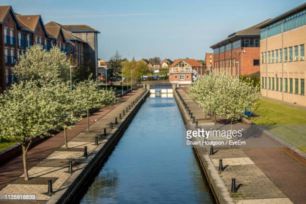 canal amidst buildings against sky - cleveland stock pictures, royalty-free photos & images