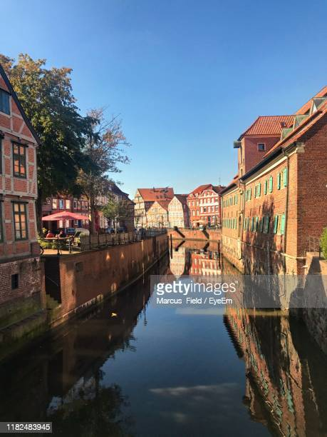 canal amidst buildings against sky - stade germany stock pictures, royalty-free photos & images