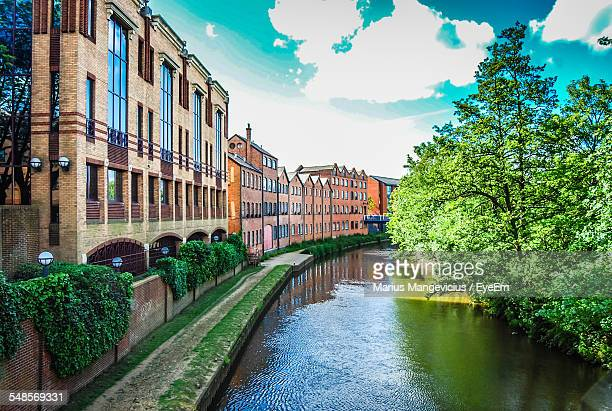 canal amidst buildings and trees in guildford - サリー州 ストックフォトと画像