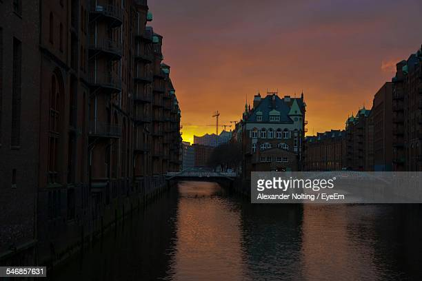 Canal Amidst Buildings At Speicherstadt