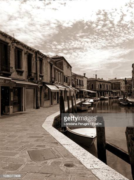 canal amidst buildings in city against sky - loredana perugini stock pictures, royalty-free photos & images