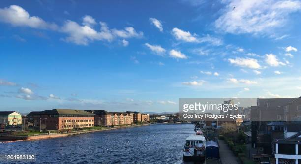 canal amidst buildings in city against sky - stockton on tees stock pictures, royalty-free photos & images