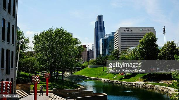canal amidst buildings on city - nebraska stock pictures, royalty-free photos & images