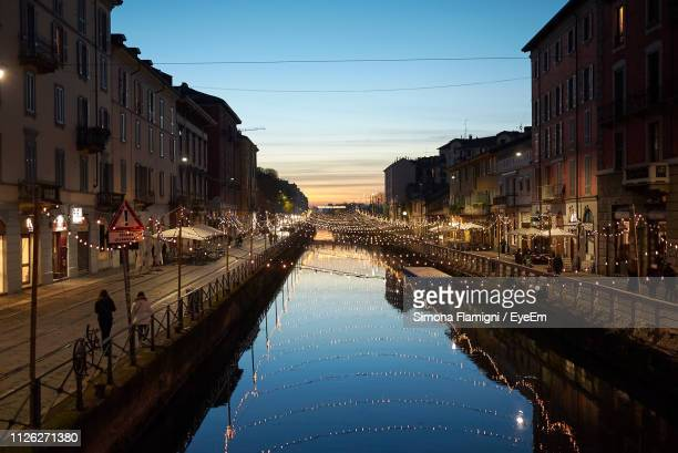 canal amidst city buildings against sky during sunset - lombardy stock pictures, royalty-free photos & images