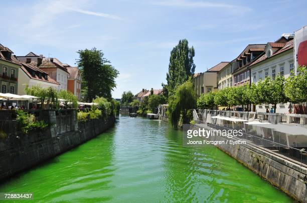 canal amidst houses against sky - espoo stock pictures, royalty-free photos & images