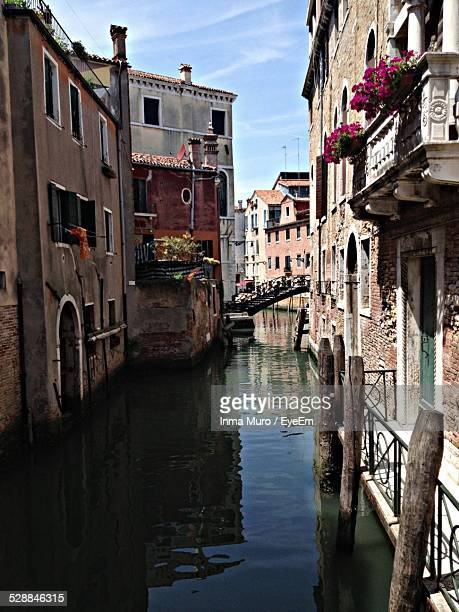 canal amidst houses - muro stock photos and pictures
