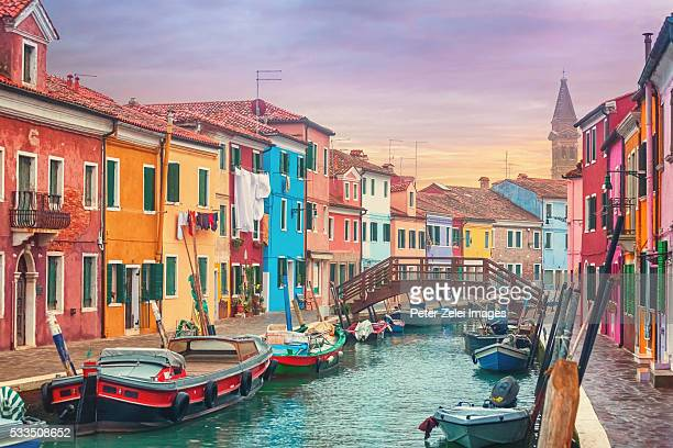 Canal and colorful houses of Burano, Italy at dusk