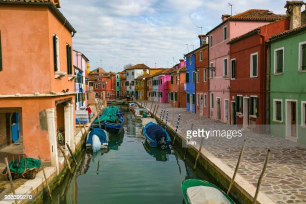 canal and colorful houses of burano, italy at dusk - murano stock pictures, royalty-free photos & images