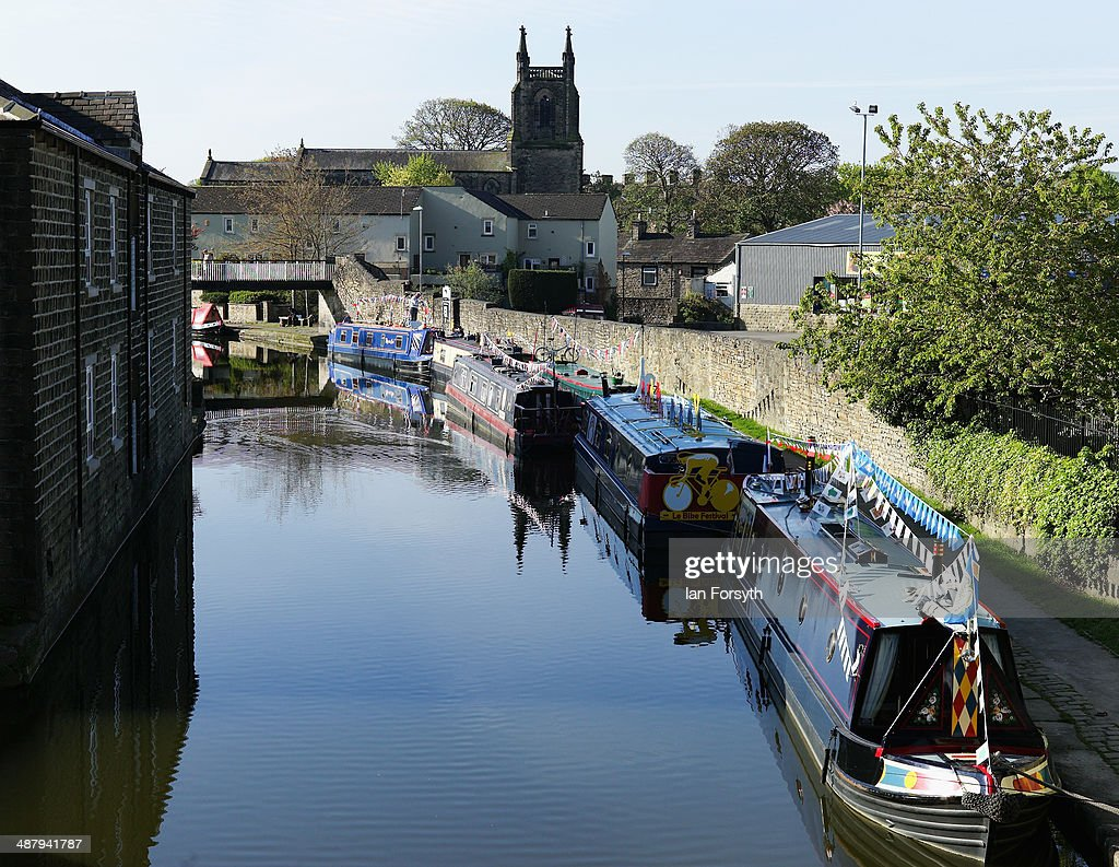 Canal boats themed to celebrate the Tour de France stages which are to be held in Yorkshire later in the year are moored up as they take part in the Skipton Waterway Festival on May 3, 2014 in Skipton, England. The Waterway festival is a three day annual canal boat event held on the Leeds and Liverpool canal. The event brings together boaters and the local community who take part in the festival activities.