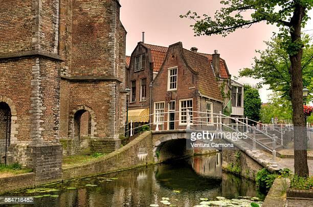 canal, bridge and nieuwe kerk, delft - nieuwe kerk delft stock photos and pictures