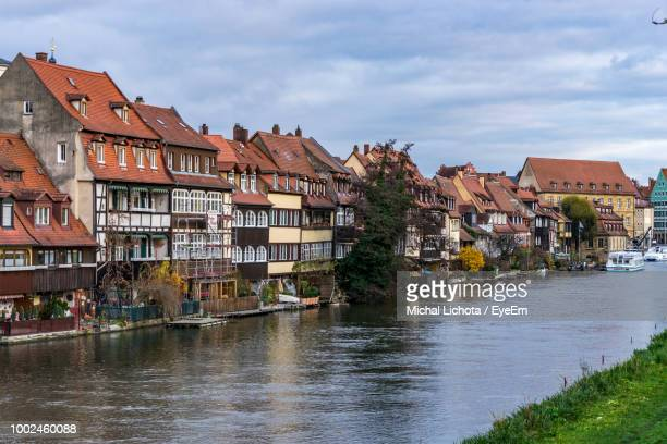 canal by buildings against sky - nuremberg stock pictures, royalty-free photos & images