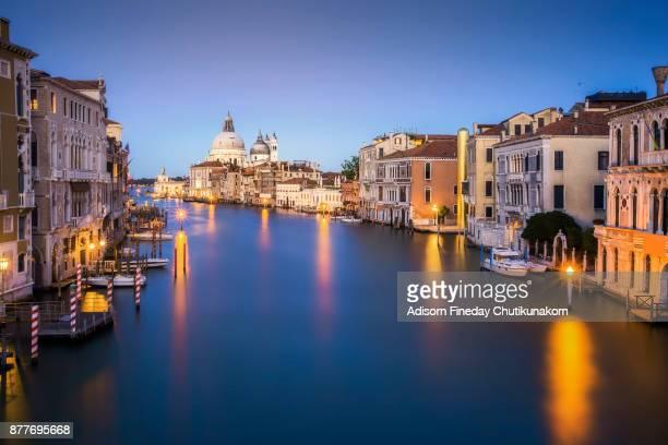 Canal Grande with Basilica di Santa Maria della Salute in the background at sunset, Venice, Italy