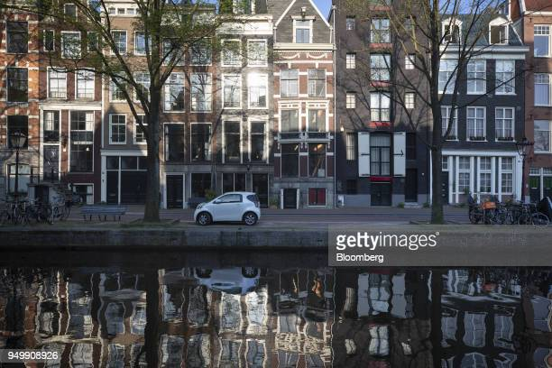 Canal houses stand along the Reguliersgracht canal in Amsterdam Netherlands on Friday April 20 2018 Brexit will lead as many as 30 significant...