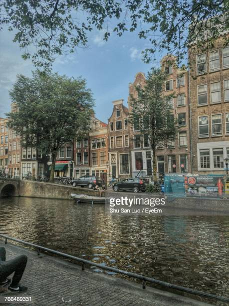 canal in city against sky - sanduíche stock pictures, royalty-free photos & images