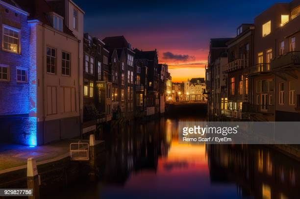 canal in city at night - dordrecht stock pictures, royalty-free photos & images