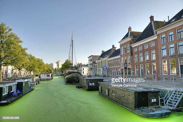 canal (gracht) in groningen - the netherlands - groningen province stock photos and pictures
