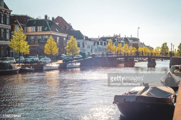 canal in haarlem, holland - haarlem fotografías e imágenes de stock
