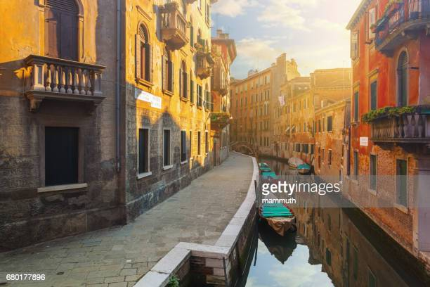 canal in venice, italy - venice italy stock photos and pictures