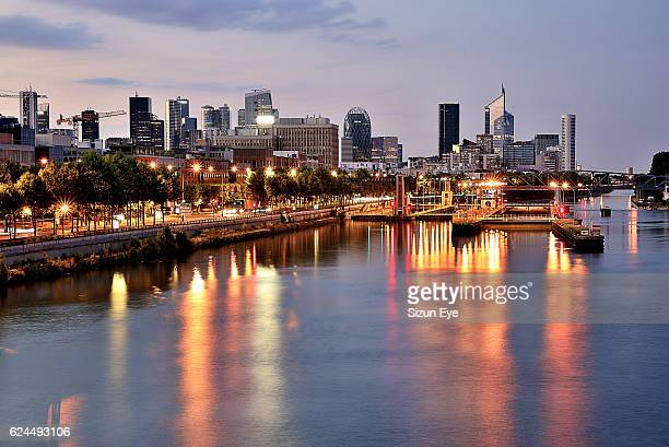 Canal lock on the Seine River and La Defense at twilight near Paris, France
