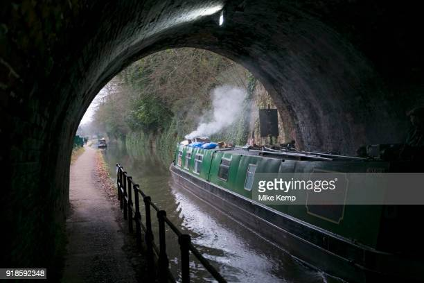 Canal narrowboat passes through a tunnel on the Worcester and Birmingham Canal in Birmingham United Kingdom The Worcester and Birmingham Canal is a...