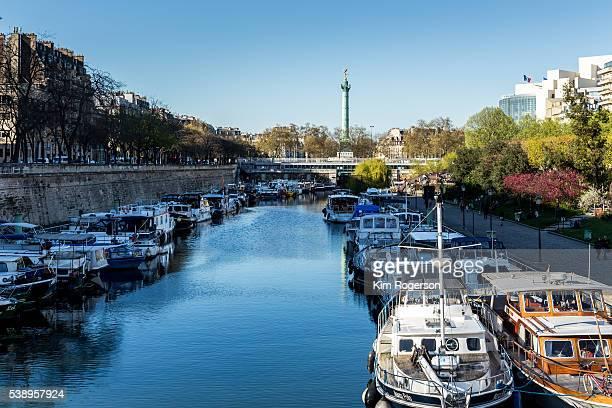 Canal of Paris, France with view of Colonne de Julliet statue