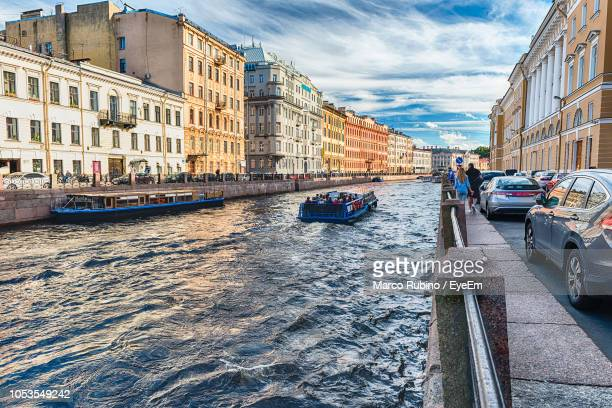 canal passing through city buildings - st. petersburg russia stock pictures, royalty-free photos & images