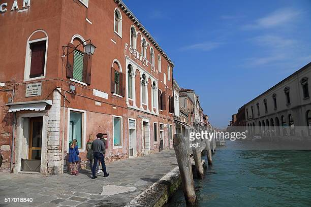 canal, people and shops in murano - pejft stock pictures, royalty-free photos & images