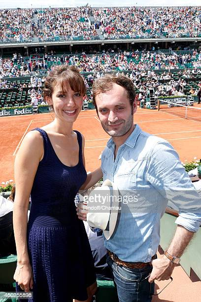 Canal Plus Miss Meteo Doria Tillier and Augustin Trapenard attend the Roland Garros French Tennis Open 2014 Day 14 on June 7 2014 in Paris France