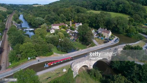 canal, railway and bridge at avoncliff, west wiltshire - vacations stock pictures, royalty-free photos & images