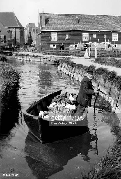 Canal scene in Volendam The Netherlands ca 1910