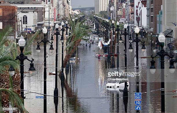 Canal Street is flooded a day after Hurricane Katrina blew through August 30, 2005 in New Orleans, Louisiana. Devastation is widespread throughout...