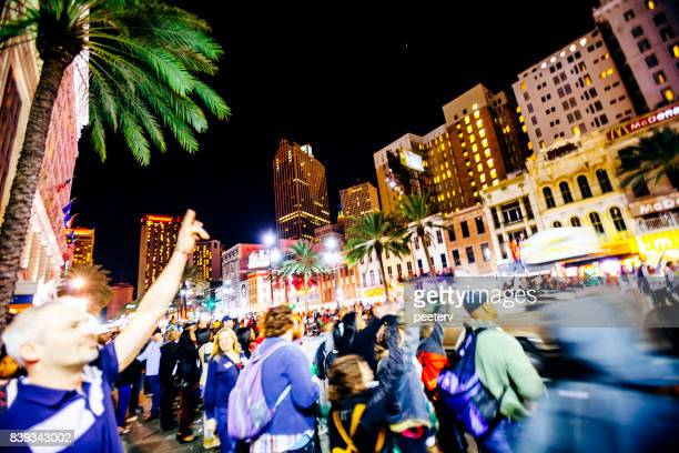 canal street mardi gras crowd, new orleans - mardi gras parade stock photos and pictures