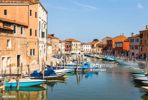 canal through the murano village in the venice lagoon in italy - murano stock pictures, royalty-free photos & images
