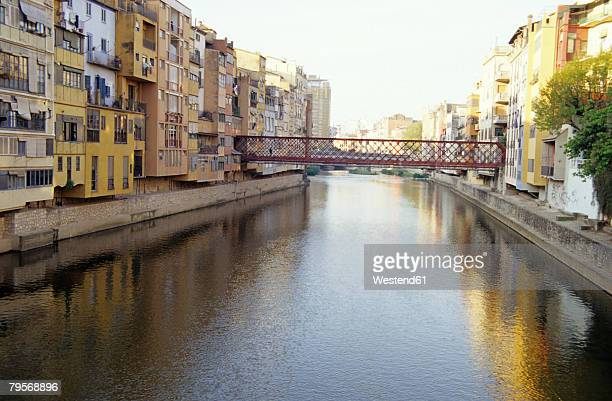 canal through village, girona, riu onyar, pont de ferro gustave eiffel, costa brava, catalonia, spain - gustave eiffel stock pictures, royalty-free photos & images