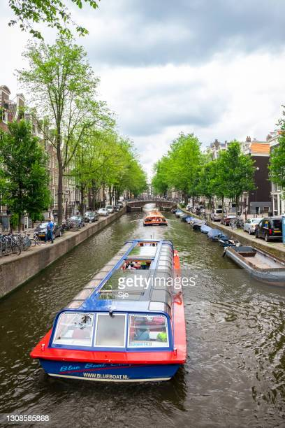 """canal tour boat  at the amsterdam keizersgracht canal - """"sjoerd van der wal"""" or """"sjo"""" stock pictures, royalty-free photos & images"""