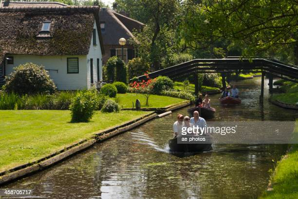 canal tour in giethoorn - giethoorn stock pictures, royalty-free photos & images
