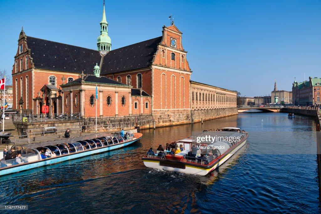 Canal tours close Holmens Kirke church, Copenhagen, Denmark. : Stock Photo