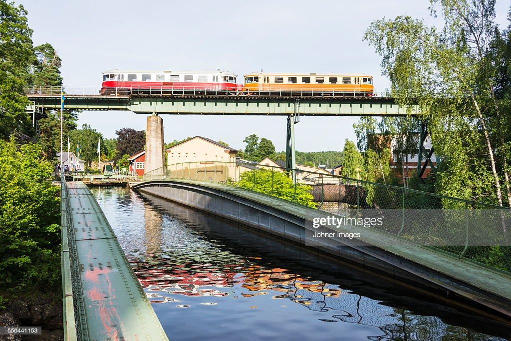 Canal, train on bridge : Stock Photo
