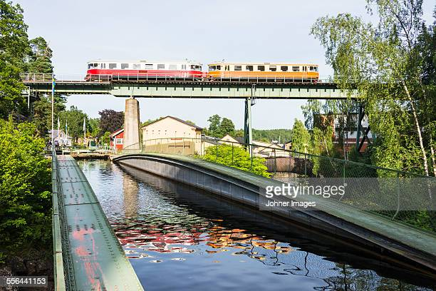 canal, train on bridge - dalsland stock photos and pictures