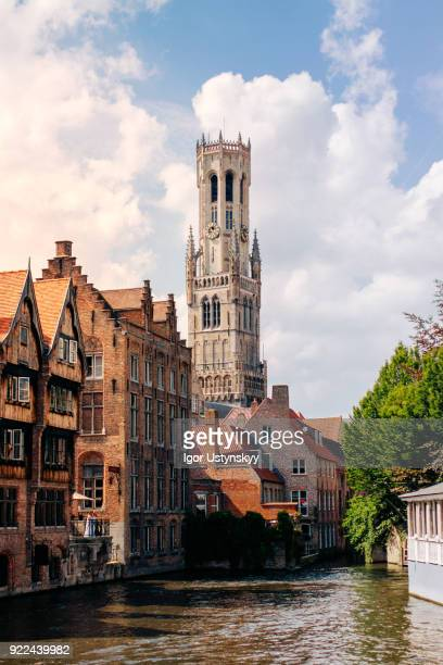 canal view of picturesque medieval bruges - bruges stock pictures, royalty-free photos & images