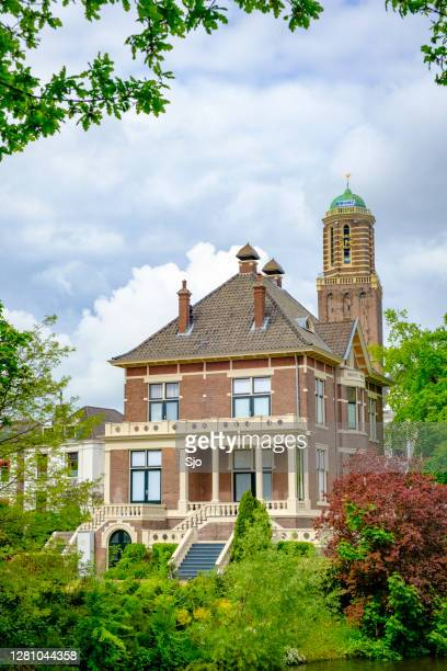 """canal villa and peperbus church tower in zwolle during a springtime daye - """"sjoerd van der wal"""" or """"sjo"""" stock pictures, royalty-free photos & images"""